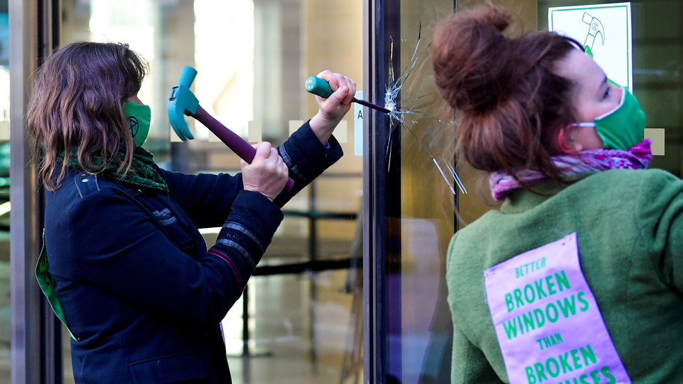 Extinction Rebellion activists arrested outside Barclays London HQ after breaking windows to protest bank's fossil fuel financing